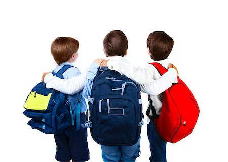 Three schoolboys isolated on white background, rear view of three teenager with colorful backpacks, best friends standing and hugs in studio, back to school, education concept Stock Photo - Budget Royalty-Free & Subscription, Code: 400-07123458