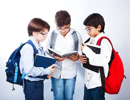 Three smart boys read books, classmates make homework, schoolboys learning lesson, clever three male pupil in glasses isolated on white background, back to school, studying and education concept Stock Photo - Budget Royalty-Free & Subscription, Code: 400-07123461