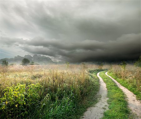 road landscape - Country road in the field on a background of thunder clouds Stock Photo - Budget Royalty-Free & Subscription, Code: 400-07166275