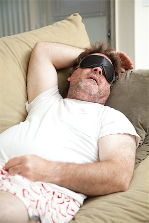 drunk passed out - Lazy, unemployed man asleep on the couch, unshaven and in his underwear. Stock Photo - Budget Royalty-Free & Subscription, Code: 400-07168202