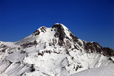 Mount Kazbek at nice winter day. Caucasus Mountains, Georgia, view from ski resort Gudauri. Stock Photo - Budget Royalty-Free & Subscription, Code: 400-07169645