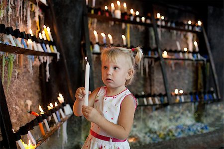 child with candles near the chirch Stock Photo - Budget Royalty-Free & Subscription, Code: 400-07175706