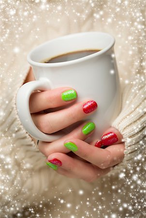 Woman in Sweater with Seasonal Red and Green Nail Polish Holding a Warm Cup of Coffee with Snow Flakes Border. Stock Photo - Budget Royalty-Free & Subscription, Code: 400-07184850