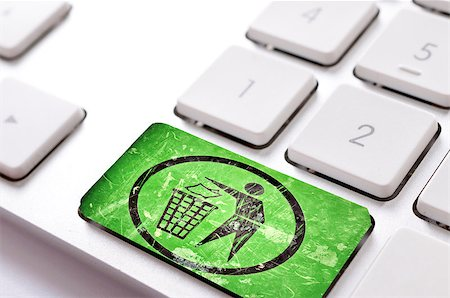 Green trash button on white keyboard Stock Photo - Budget Royalty-Free & Subscription, Code: 400-07206924