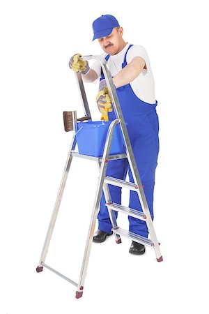 house painter and ladder over white background Stock Photo - Budget Royalty-Free & Subscription, Code: 400-07215542