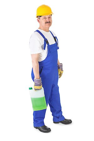 manual worker with washer fluid over white background Stock Photo - Budget Royalty-Free & Subscription, Code: 400-07211753