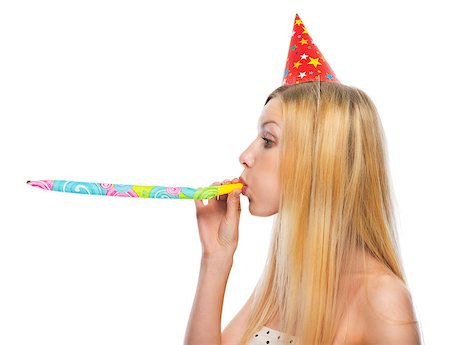 Profile portrait of teenage girl in cap blowing in party horn blower Stock Photo - Budget Royalty-Free & Subscription, Code: 400-07222563
