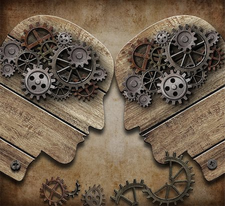 two wooden heads with gears coming into collision concept Stock Photo - Budget Royalty-Free & Subscription, Code: 400-07245027