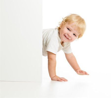 Funny kid on all fours behind wall Stock Photo - Budget Royalty-Free & Subscription, Code: 400-07245029