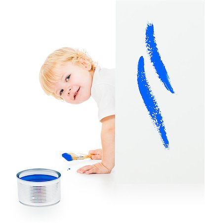 Baby boy with paint brush on all fours behind painted white wall Stock Photo - Budget Royalty-Free & Subscription, Code: 400-07246778