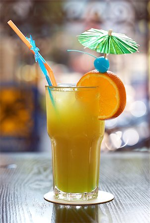Tropical cocktail in glass with straw Stock Photo - Budget Royalty-Free & Subscription, Code: 400-07247942