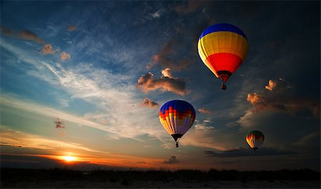 Colorful hot air balloon is flying at sunrise Stock Photo - Budget Royalty-Free & Subscription, Code: 400-07248879
