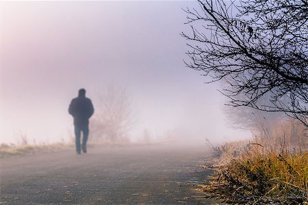 road landscape - A person walk into the misty foggy road in a dramatic sunrise scene with abstract colors Stock Photo - Budget Royalty-Free & Subscription, Code: 400-07256661
