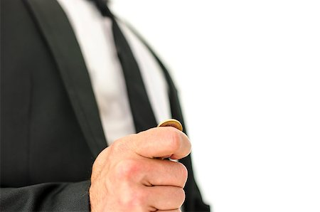 Closeup  of businessman hand flipping  a coin. Isolated over white background. Stock Photo - Budget Royalty-Free & Subscription, Code: 400-07258748
