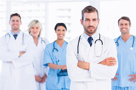 Portrait of confident happy group of doctors standing at the medical office Stock Photo - Budget Royalty-Free & Subscription, Code: 400-07276029