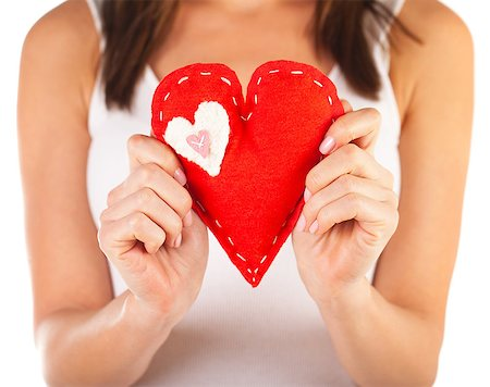 Picture of brunette woman holding red soft toy heart-shaped in hands, beautiful handmade present for Valentine day, romantic holiday, affection feelings, health care and medicine, love concept Stock Photo - Budget Royalty-Free & Subscription, Code: 400-07272530