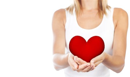 Healthy woman holding heart in hands, female body isolated on white background, conceptual image of health care and love, girl with symbol of Valentine's day, selective focus, shallow dof Stock Photo - Budget Royalty-Free & Subscription, Code: 400-07272547