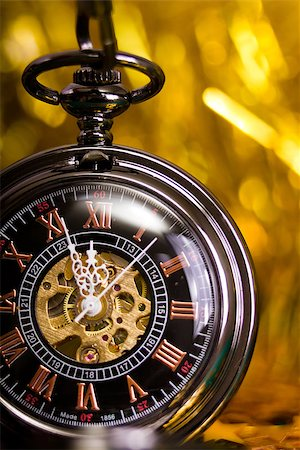 pzromashka (artist) - beautiful pocket watch arrows indicate midnight. macro Stock Photo - Budget Royalty-Free & Subscription, Code: 400-07294045