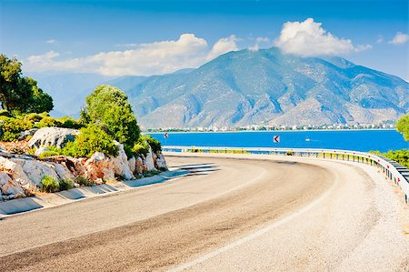 road landscape - sharp bend in the road and the view of the mountain Stock Photo - Budget Royalty-Free & Subscription, Code: 400-07299948
