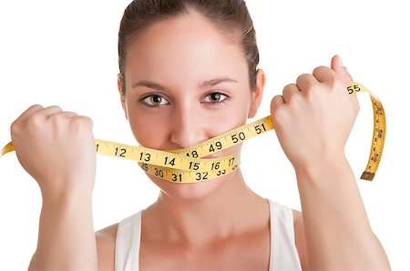 Woman with a yellow measuring tape around her mouth, isolated in white Stock Photo - Budget Royalty-Free & Subscription, Code: 400-07290753
