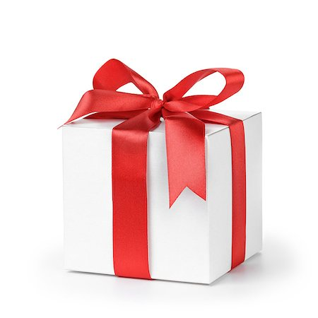 paper gift box wrapped with ribbon, isolated on white Stock Photo - Budget Royalty-Free & Subscription, Code: 400-07292217