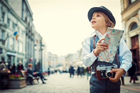Tourist with map on the street Stock Photo - Budget Royalty-Free & Subscription, Code: 400-07306405