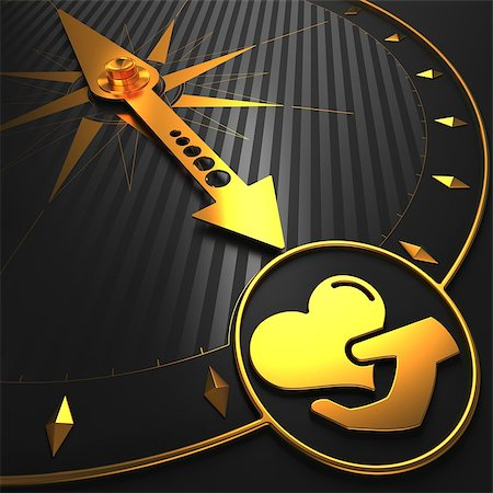 Golden Icon of Heart in the Hand on Black Compass. Stock Photo - Budget Royalty-Free & Subscription, Code: 400-07306687