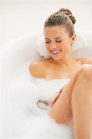 Smiling young woman laying in bathtub Stock Photo - Budget Royalty-Free & Subscription, Code: 400-07307400