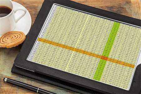 business concept - data spreadsheet on a digital tablet with a cup of coffee Stock Photo - Budget Royalty-Free & Subscription, Code: 400-07309458