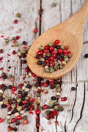 pimento - mixture of peppers in spoon closeup on rustic wooden background Stock Photo - Budget Royalty-Free & Subscription, Code: 400-07302395