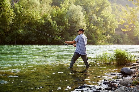 diego_cervo (artist) - mid adult man on holidays on river, relaxing and fishing trout Stock Photo - Budget Royalty-Free & Subscription, Code: 400-07303889