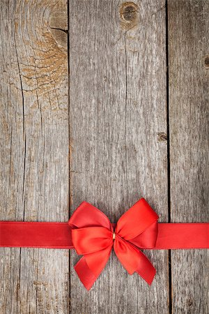 Wooden background with red bow and ribbon with copy space Stock Photo - Budget Royalty-Free & Subscription, Code: 400-07320193