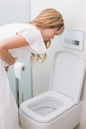 Young woman with stomach sickness about to vomit into a toilet Stock Photo - Budget Royalty-Free & Subscription, Code: 400-07343634