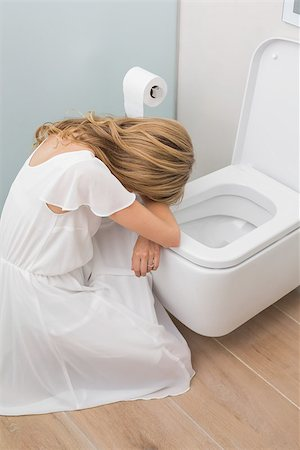High angle view of a sick young woman sitting in the toilet Stock Photo - Budget Royalty-Free & Subscription, Code: 400-07343648