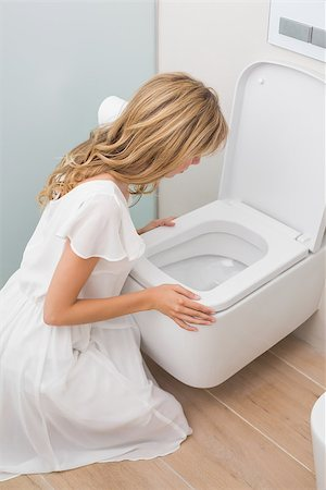 High angle view of a young woman about to vomit into a toilet Stock Photo - Budget Royalty-Free & Subscription, Code: 400-07343652