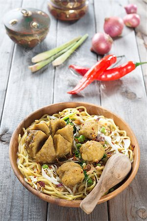 Mee bakso. Bakso or baso is Indonesian meatball  made from beef surimi. Popular local food in Indonesia.  Fresh hot with steam smoke. Stock Photo - Budget Royalty-Free & Subscription, Code: 400-07418409