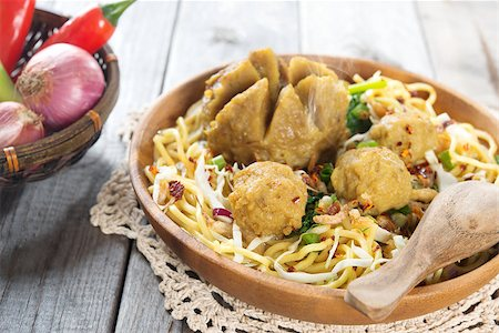 Indonesian meatball  noodles or mee bakso, popular Indonesian street food. Fresh hot with steam smoke. Stock Photo - Budget Royalty-Free & Subscription, Code: 400-07418412