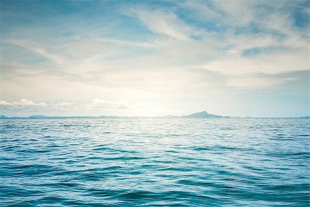 Blue sunny sea and cloudy blue sky Stock Photo - Budget Royalty-Free & Subscription, Code: 400-07410509