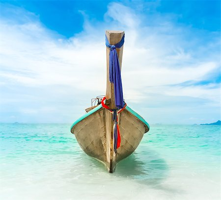 long boat, blue sky, clear water in Thailand Stock Photo - Budget Royalty-Free & Subscription, Code: 400-07410513