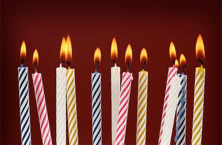 Some lit birthday candles close up Stock Photo - Budget Royalty-Free & Subscription, Code: 400-07412406