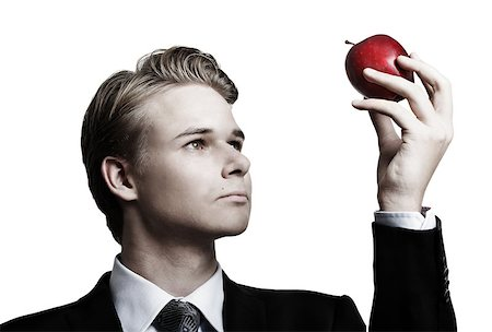 Young businessman and apple Stock Photo - Budget Royalty-Free & Subscription, Code: 400-07424704