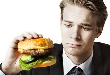 Businessman eating at work Stock Photo - Budget Royalty-Free & Subscription, Code: 400-07424705