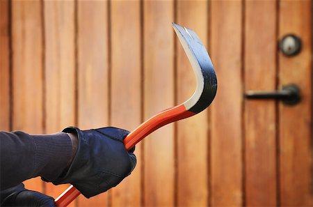 Burglar hand holding crowbar Stock Photo - Budget Royalty-Free & Subscription, Code: 400-07424701
