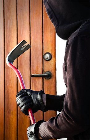 Burglar hand holding crowbar Stock Photo - Budget Royalty-Free & Subscription, Code: 400-07424702