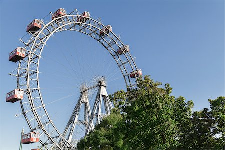 dpruter - The Wiener Riesenrad is a Ferris wheel at the entrance of the Prater amusement park in Vienna, It is one of most popular tourist attractions in Vienna. Austria Stock Photo - Budget Royalty-Free & Subscription, Code: 400-07424909