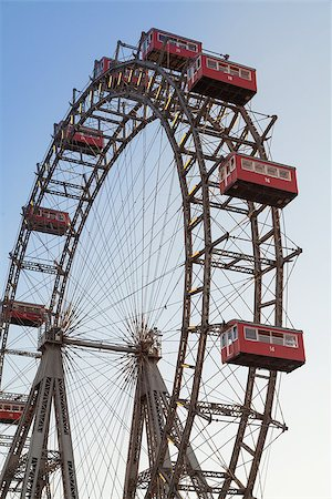 dpruter - The Wiener Riesenrad is a Ferris wheel at the entrance of the Prater amusement park in Vienna, It is one of most popular tourist attractions in Vienna. Austria Stock Photo - Budget Royalty-Free & Subscription, Code: 400-07424915