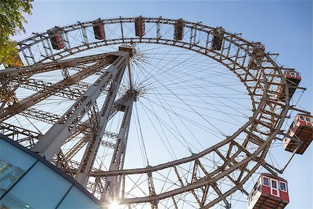 dpruter - The Wiener Riesenrad is a Ferris wheel at the entrance of the Prater amusement park in Vienna, It is one of most popular tourist attractions in Vienna. Austria Stock Photo - Budget Royalty-Free & Subscription, Code: 400-07424911