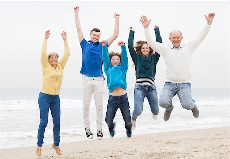 Happy family jumping on the air at beach Stock Photo - Budget Royalty-Free & Subscription, Code: 400-07426222