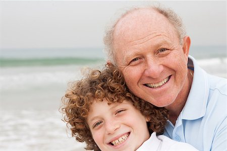 Happy grand father with grandson on beach Stock Photo - Budget Royalty-Free & Subscription, Code: 400-07426223