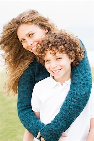 Happy mother playing with her son in the park Stock Photo - Budget Royalty-Free & Subscription, Code: 400-07426235